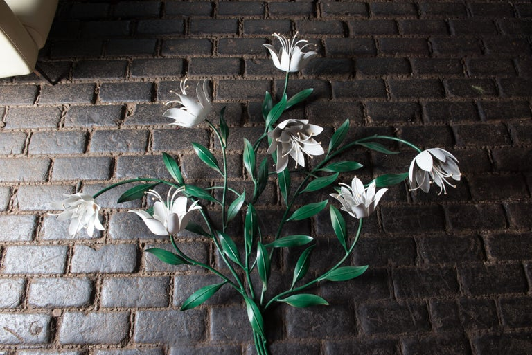 Large wrought iron tulip-like flower wall decoration. Green painted stems and leaves and white flowers. Made in Italy.