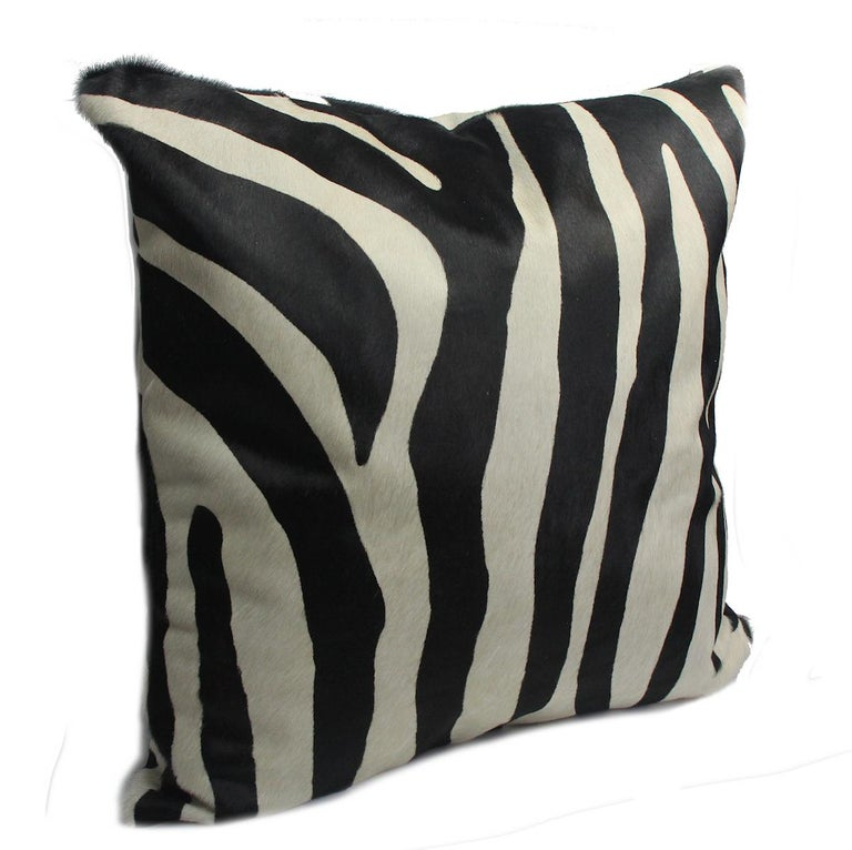 Add touches of exotic flare to your interiors with this large zebra print pillow cover. Australian Designer and Artisan, Emily Barbara personally pre-selects and pre-patterns her zebra print cowhide skins so that she may capture the striking pattern