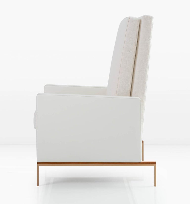 KGBL deconstructed the armchair to create the Larkin. Back and arms float away from a delicate metal and wood base. Semi-attached back and seat cushions are down filled for a supremely comfortable sit. Shown with Solid Silicon Bronze/Teak base and
