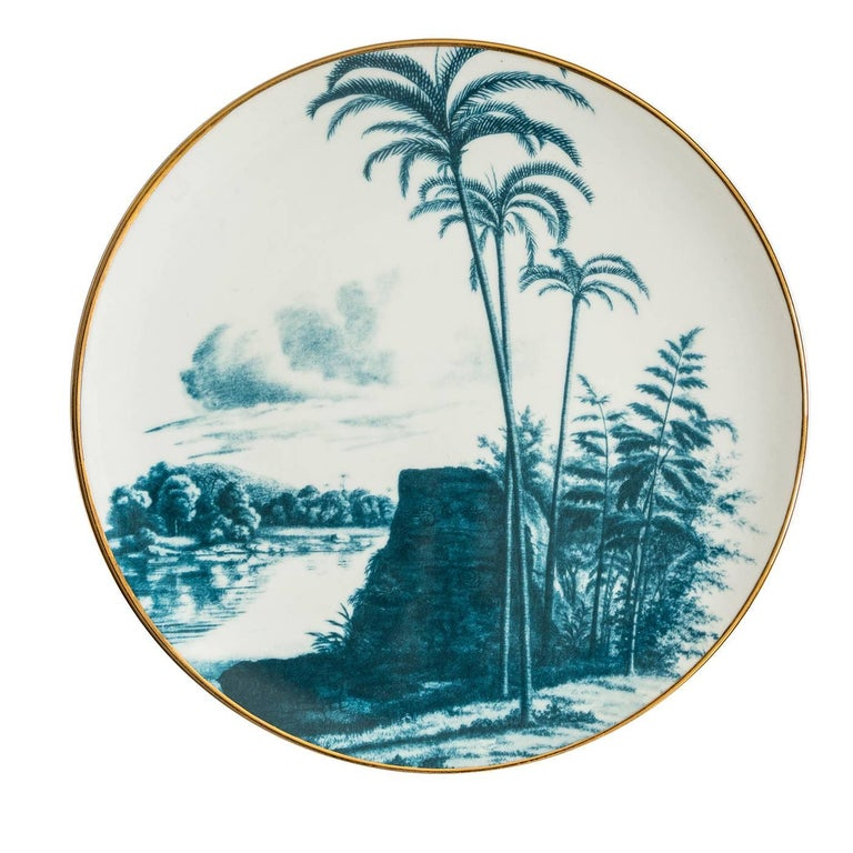 This exquisite set of six porcelain plates is part of the Las Palmas series inspired by Vito Nesta's travels around the world. The landscapes evoke the Amazon Rainforest near the city of Palmas, Brazil, depicted in a muted green that enhances the