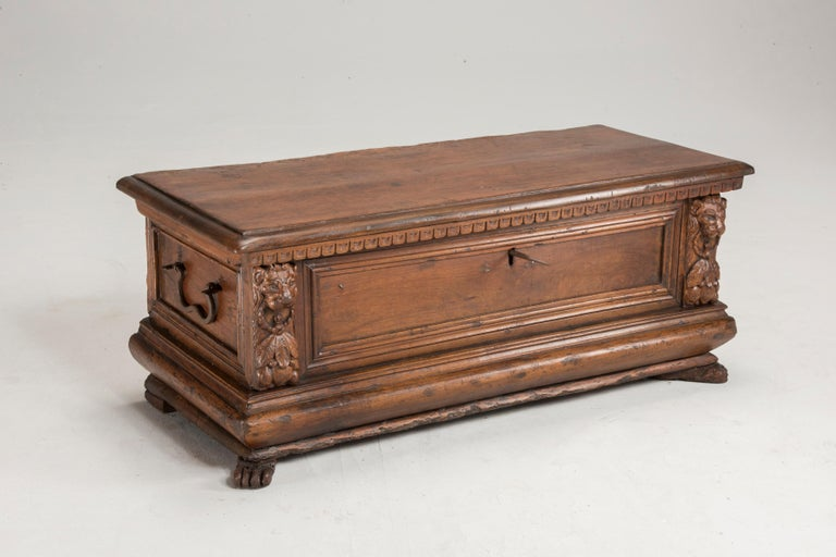 Late 16th century walnut wood chest. All the parts are original such as lion feet shaped feet as well, which are very difficult to be found as original. It is engraved with lion shaped details and features original hardware. It has been restored in