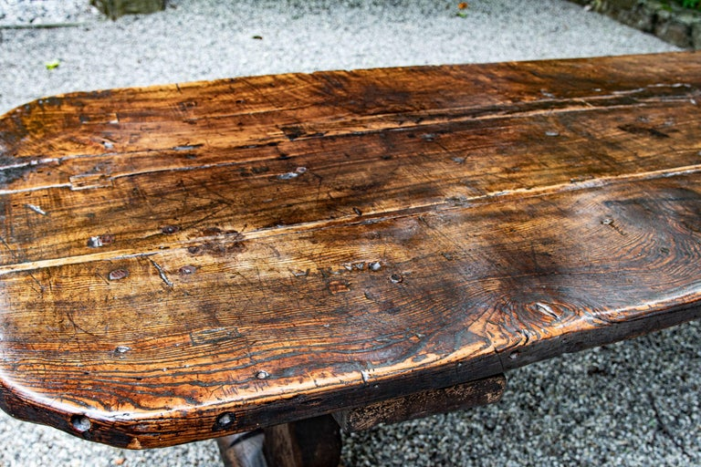 Fabulous late 16th century, possibly early 17th century Welsh oak refectory table. Absolutely superb color and patina. The long planked top sits over a single hidden stretcher on two sledge feet, circa 1590-1630. The table is well preserved, and