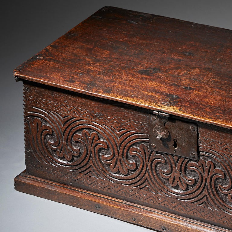A superb and original late 17th century oak box with excellent and deep lunette carving and well-patinated surfaces throughout, circa 1670-1680. 