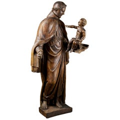 Late 17th Century Italian School Wooden Sculpture of Saint Anthony and the Child