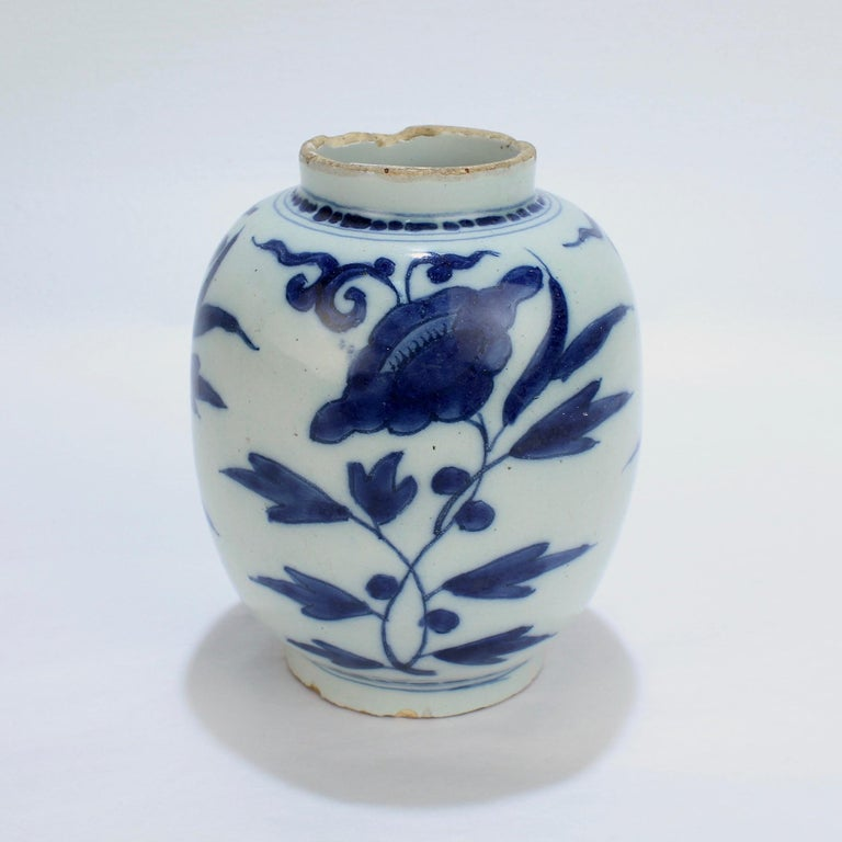 A fine, diminutive, and early Dutch Delft pottery vase or jar marked for Gerrit Kam.  With a stylized Chinese peony flower pattern.  Bearing an underglaze blue GK monogram to the base for Gerrit Kam.  During his lifetime, Kam was active both in the