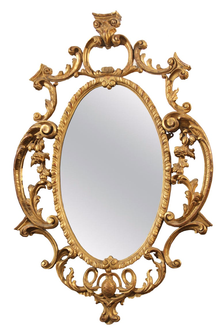 Large oval carved wood and gilt frame mirror. Ornate hand carving with lovely distressed mirror.