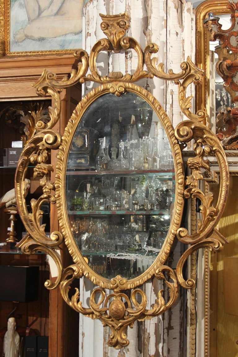 Giltwood Late 18th Century Ornate Carved Wood and Gilt Mirror For Sale