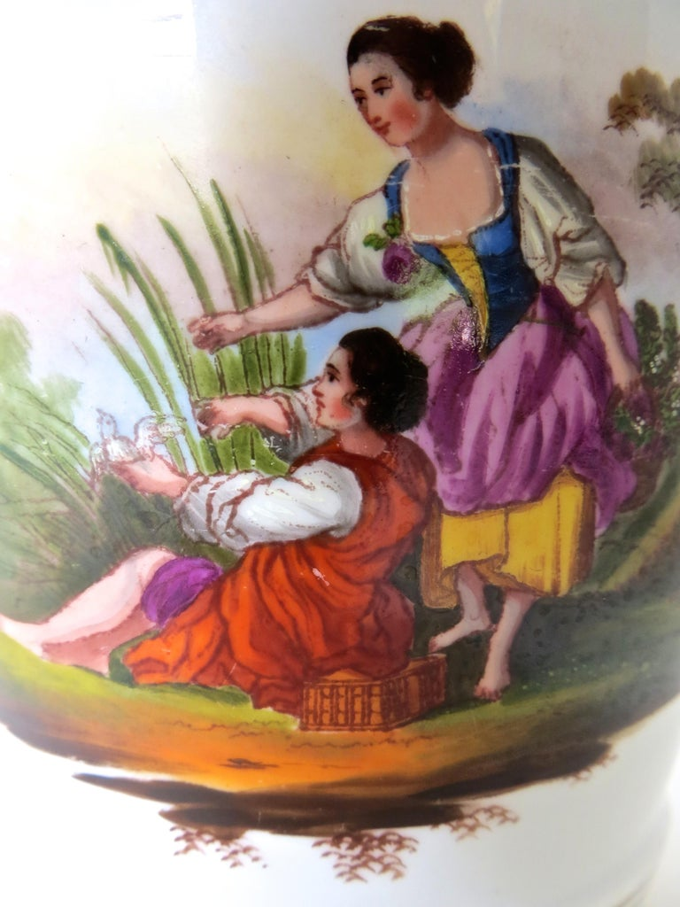 Fine quality English late 18th century faience planter or pot, with accompanying small porcelain stand. The hand painted image depicts a young couple handsomely dressed in bright colors, seated beneath a tree in a country setting (see image). A four
