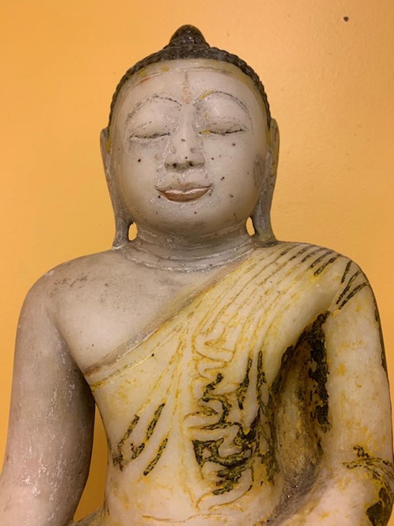 Late 18th century Stone Shan State, Burmese, (Myanmar) Buddha collected eighteen years ago in the Shan State while collecting for an Asian Art museum. Absolute stunning presence with pigments left over from the many Buddhist cleansing ceremonies it