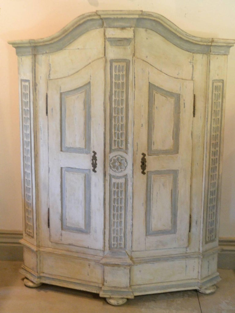 Late 18th century armoire in painted wood. Not all original Paint, circa 1780
