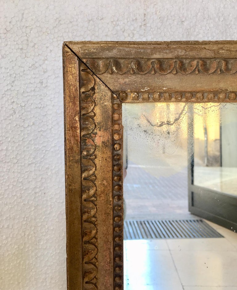 Mercury Glass Late 18th Century French Louis XVI Carved Giltwood Mirror For Sale
