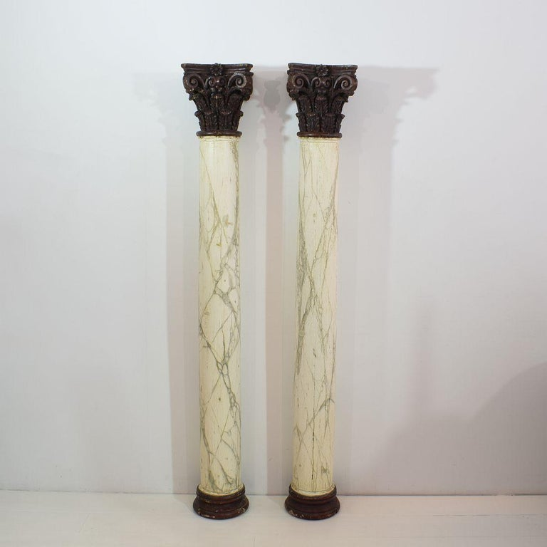 Spectacular pair of late 18th century Corinthian columns with their faux marble paint. , Great patina. Italy circa 1780. Weathered, small losses. More pictures available on request.