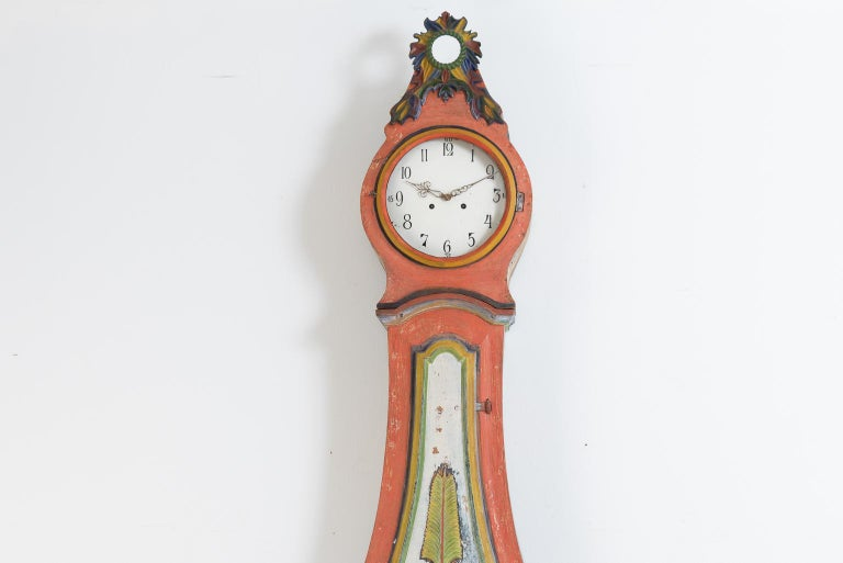 Gustavian model long case clock from northern Sweden. All the embellishments are carved wooden decorations. The clock mechanism is serviced and functional at the time of writing but we cannot provide any guarantees for future function. The clock has