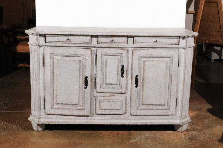 A Swedish Gustavian period painted wood sideboard from the late 18th century, with canted side posts, four drawers and three doors. Born in Sweden during the early years of King Gustav III's reign, this painted sideboard features a rectangular top