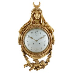 Late 18th-Early 19th Century Swiss Quarter Striking Carved Giltwood Cartel Clock