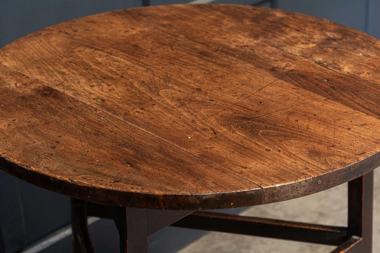 Circa 1780.  Late 18thC English ash & fruitwood cricket / tavern table.  Three plank top with wonderful colour, wear and patination, supported by square stretchers and elegant tapered legs  Measures: Diameter 62 x height 72cm.