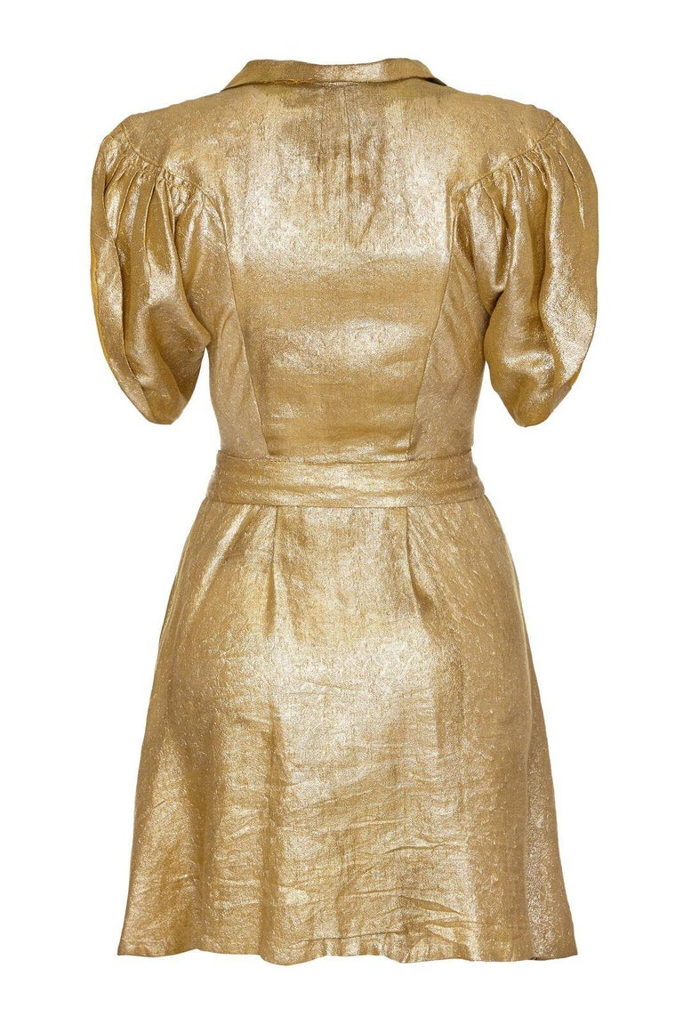 This incredible gold lame party dress circa late 1930s is in wonderful vintage condition and is undeniably modern for a piece of this era. The soft gold metallic fabric is beautifully tailored in the bodice with batwing style sleeves curving in