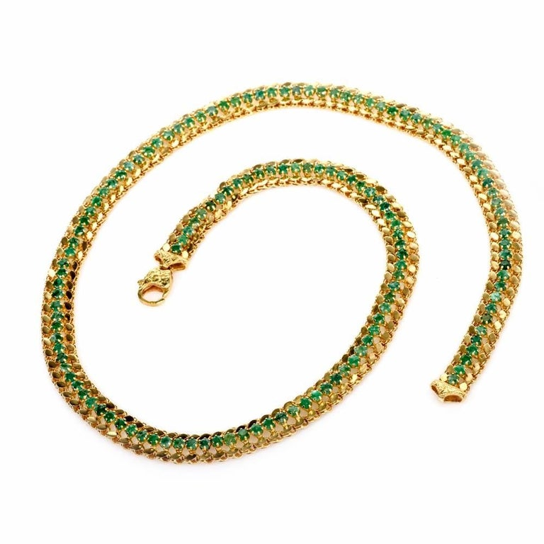This alluringly delicate, classically elegant yellow gold and emerald vintage necklace is designed and manufactured by Murat Jewelers  and bears their signature and the purity mark '750'.  The necklace weighs 29.2 grams and measures 19 inches long