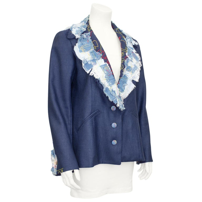 John Galliano blazer from his early collections in the late 1980s. Navy blue linen, treated to look like denim with deconstructed blue denim, white eyelet cotton, mesh and gingham patchwork at the collar and cuffs. Abstract top stitching in red,