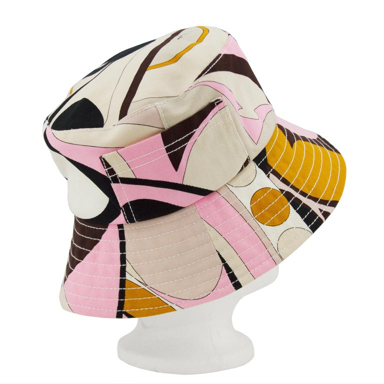 Emilio Pucci brown, pink, beige and yellow abstract printed canvas bucket hat from the late 1990s, early 2000s. A snug fit with a white interior and cream stitching along the brim. In excellent condition, one pocket on the exterior, perfect for a