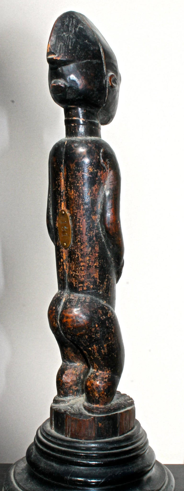 Carved Late 19 Century Tribal Baule Male Figure with Period Mount African Art For Sale