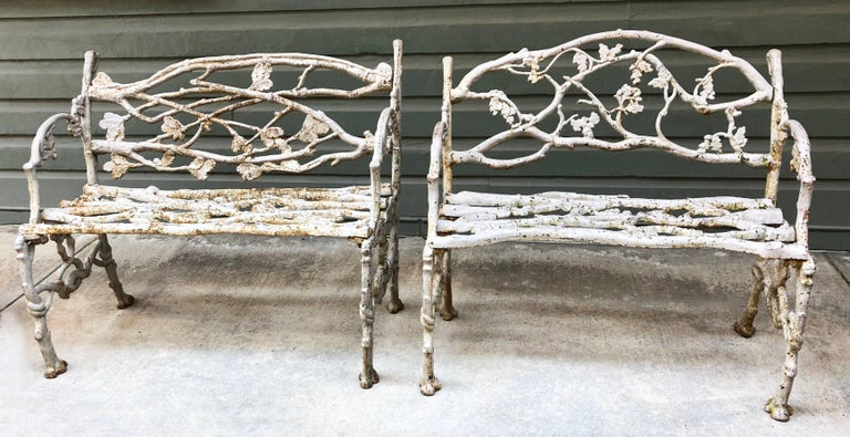 These late 19th century American cast iron garden benches have a twig and serpent pattern that originated in England and Scotland.  The benches are different dimensions: 33.25