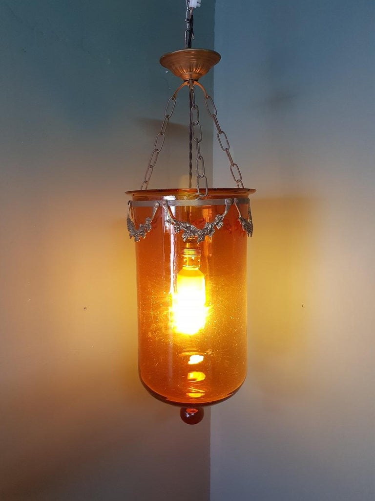 Antique brown glass 1 light bell jar lantern with bronze frames in the form of garlands and has been rewired, late 19th century beginning.  The measurements are, Depth 25 cm/ 9.8 inch. Width 25 cm/ 9.8 inch. Height 70 cm/ 27.5 inch.