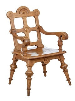 Late 19th Century carved oak arts and crafts armchair