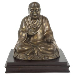 Late 19th Century Chinese Gold Fleck Cast Bronze Figure of Buddha