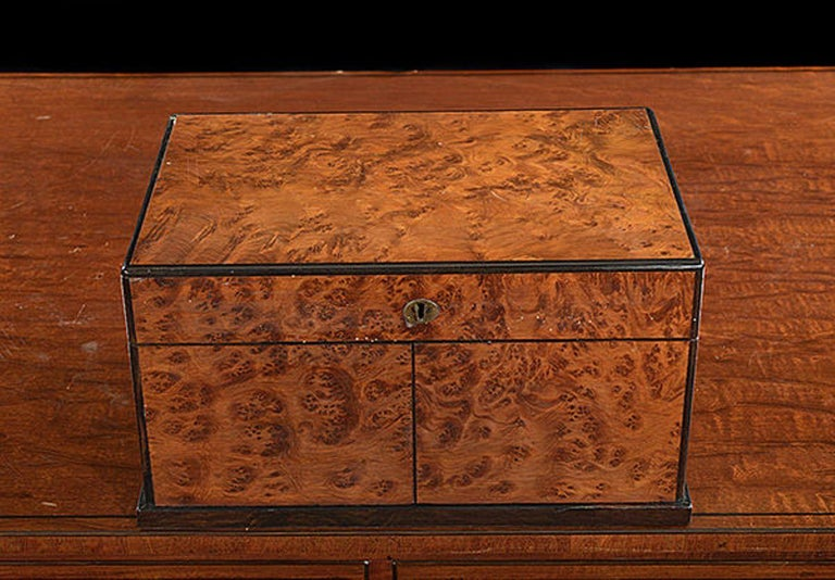 A Victorian burr yew wood and Coromandel box cabinet compendium of games which includes cribbage, chess, draughts and cards. The rising lid with a folding chess board stored inside: the pair of fold back doors to the front store the chess pieces