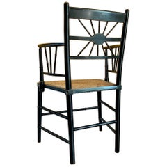 Late 19th Century Ebonized Sussex Chair with Cane Seat and Painted Detail