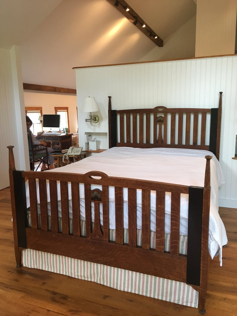 Late 19th-early 20th century English Arts & Crafts oak Queen bed frame with pewter inlay. A matching set including a full size Arts & Crafts bed which was converted to a Queen from a full size, made from solid oak, ebony and pewter. The two black