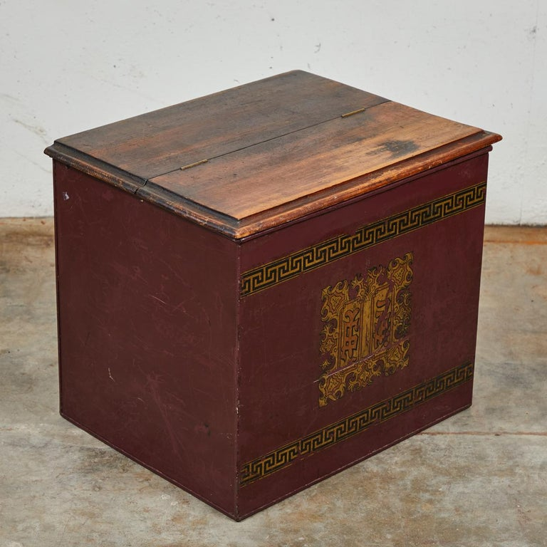 Late 19th century English tin and wood storage box. Box sides are tin with a wood top and gilt detailing.