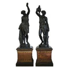 Late 19th Century Faux Bronze Gesso Statues of a Hunter and his Companion, Pair