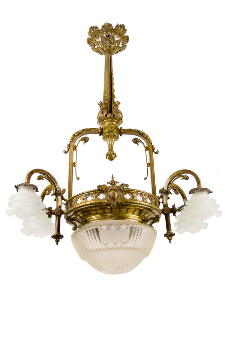 Late 19th century French Victorian style electrified gas five-light chandelier. Four bronze arms, each with socket for B22 bulb with new wiring and floral shaped, frosted glass shade (newer shades). The bottom centered with original cut glass bowl.