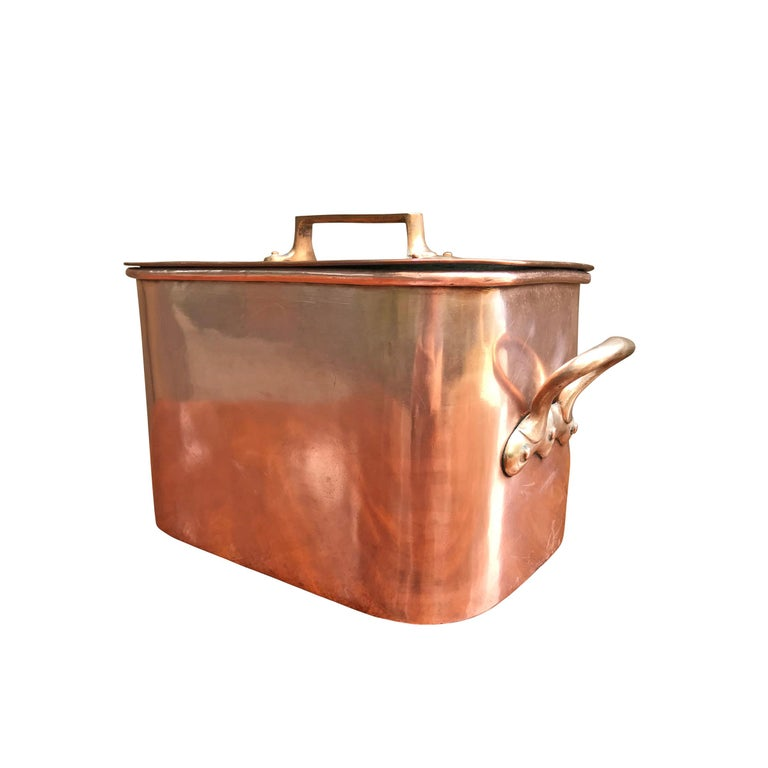 A wonderful late 19th century French copper Daubiere by J. Jacquotot with bronze handles, dovetailed joinery up the sides and around the bottom, and a lid with a bronze handle. Daubiere are braising pans used to roast inexpensive cuts of meat with