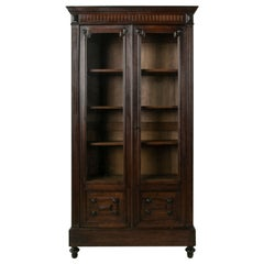 Late 19th Century French Henri II Walnut Bookcase with Hand Blown Glass Doors