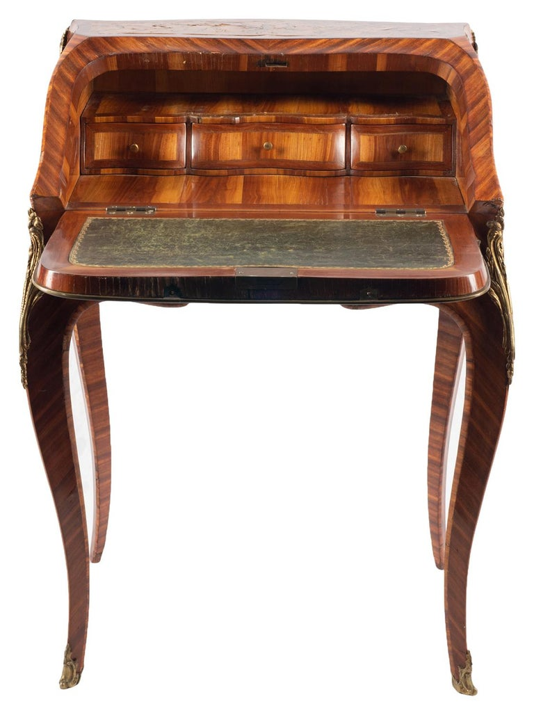 A good quality late 19th century French bureau De-Dame, having wonderful marquetry floral inlay to the fall and top, opening to reveal a shelf, drawers and a slide opening to a well. Raised on elegant ormolu mounted cabriole legs, terminating in
