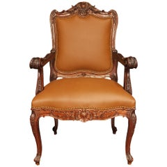 Late 19th Century French Louis XV Style Walnut and Leather Armchair