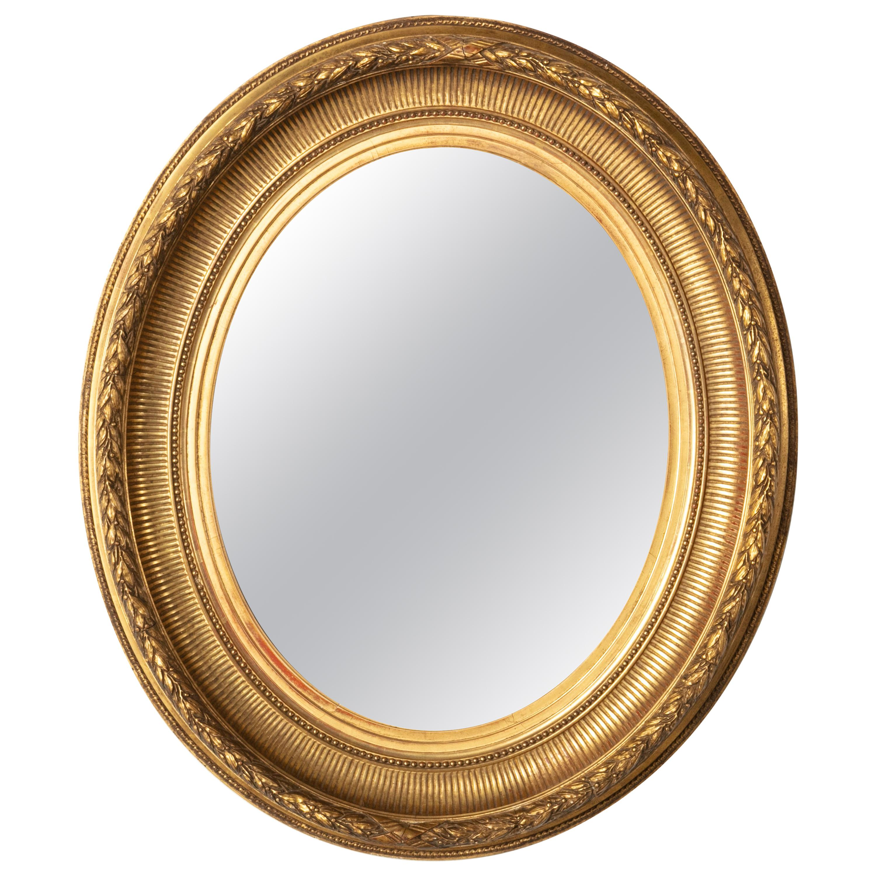 Late 19th Century French Louis XVI Style Oval Giltwood Mirror