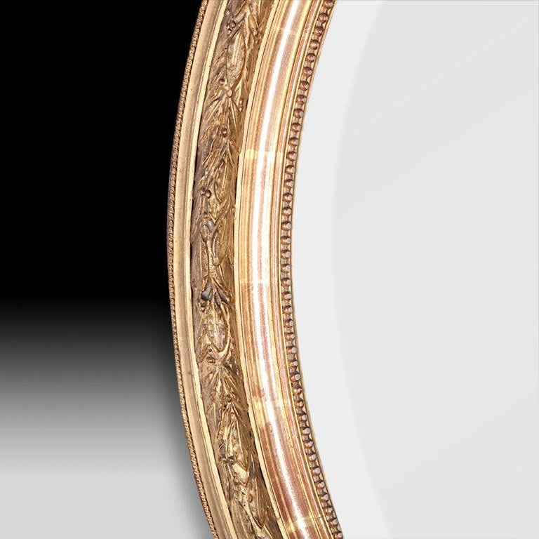 Giltwood Late 19th Century French Oval Gilt Framed Louis XVI Mirror For Sale