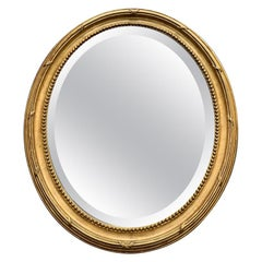 Late 19th Century French Oval Gilt Mirror with Original Bevelled Glass
