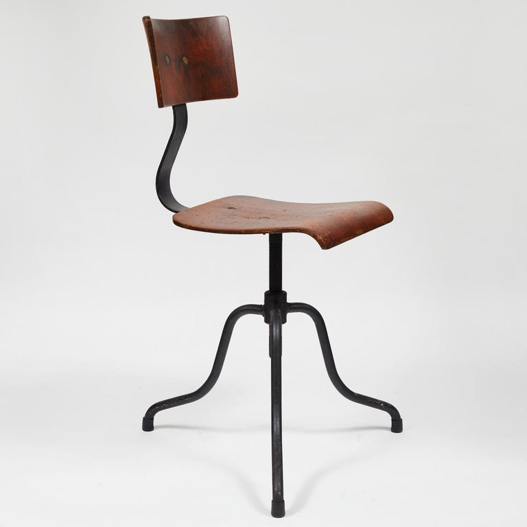 Adjustable bentwood and iron splayed legs swivel chair (four available).