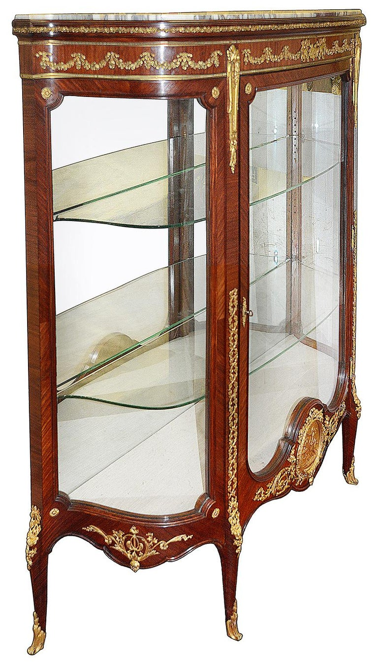 A fine quality late 19th century French Louis XVI style mahogany vitrine, having wonderfully fine quality gilded ormolu mounts. Having its original marble top, the single glazed door opening to reveal adjustable glass shelves within. A classical