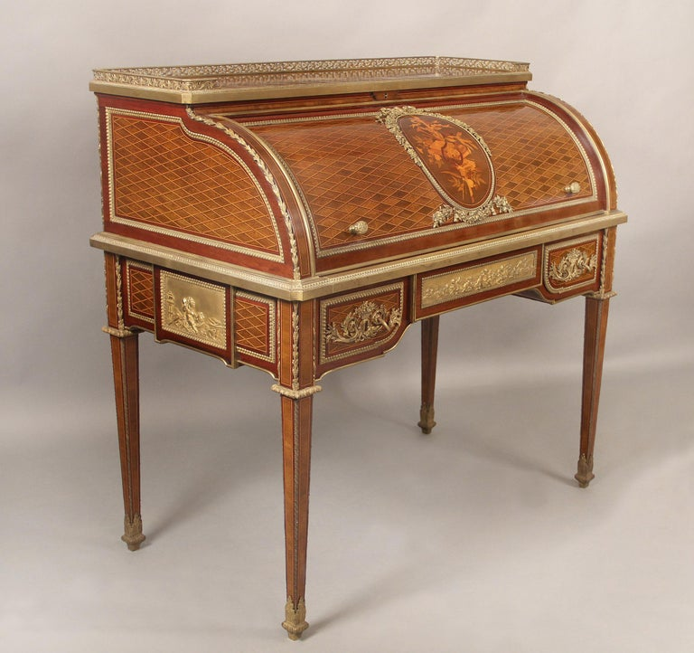 An excellent quality late 19th century gilt bronze mounted marquetry and parquetry bureau a cylinder by François Linke  François Linke – Index no. 100  The rectangular galleried top inlaid with lozenge parquetry, above a cylinder roll-top