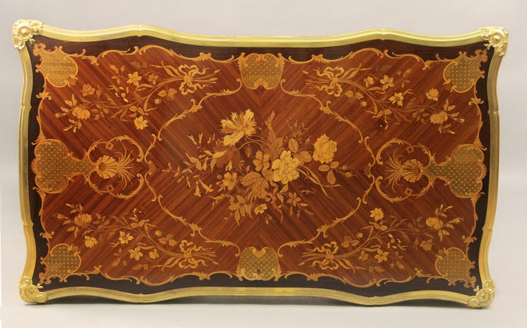 A fantastic late 19th century Louis XV style gilt bronze-mounted inlaid marquetry table