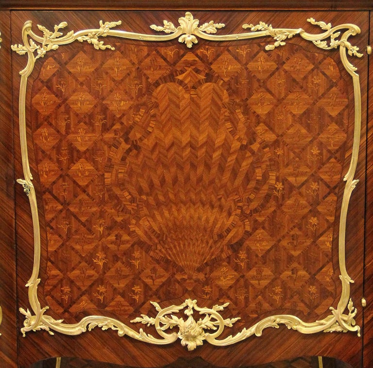 A lovely late 19th century Louis XV style gilt bronze mounted inlaid marquetry and parquetry cabinet by François Linke
