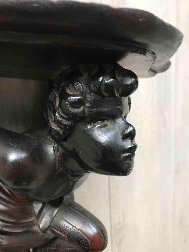 Wood Late 19th Century Hand Carved and Ebonized Venetian Boy Sculpture Wall Bracket For Sale