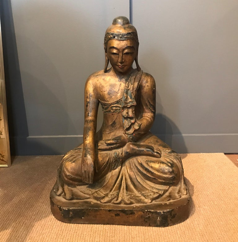 Excellent hand carved wood Buddha from Thailand late 19th century retaining most of the original gilt with expected signs of age and use.