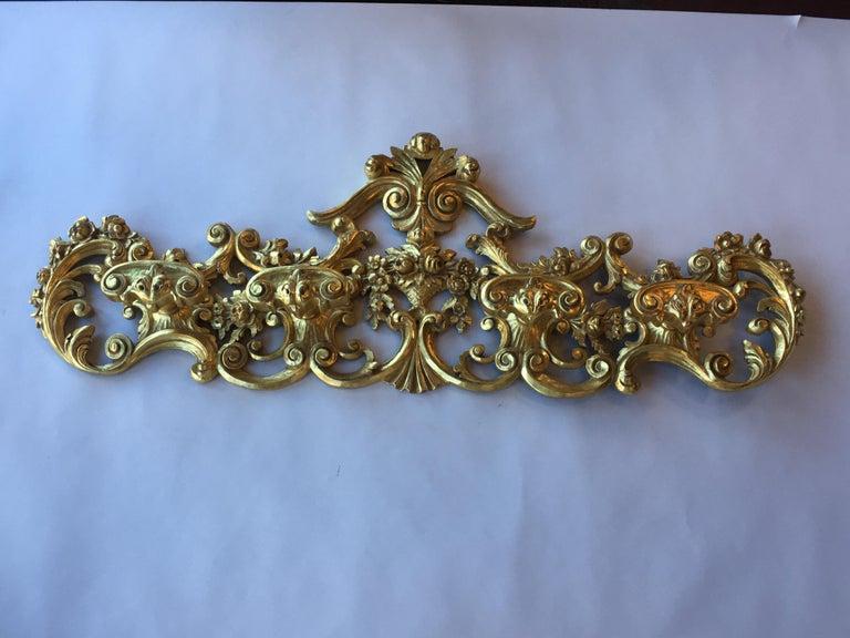 Late 19th century Italian hand carved 22-karat gold coat hanger.